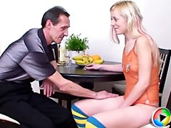 Blonde cutie pie gives herself to the old teacher and gets fucked right on a round table