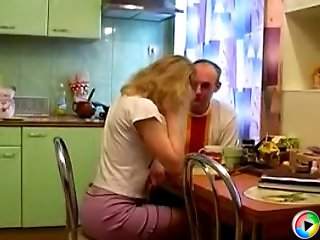 Old guy gets a hot young pussy over his cock right in the kitchen